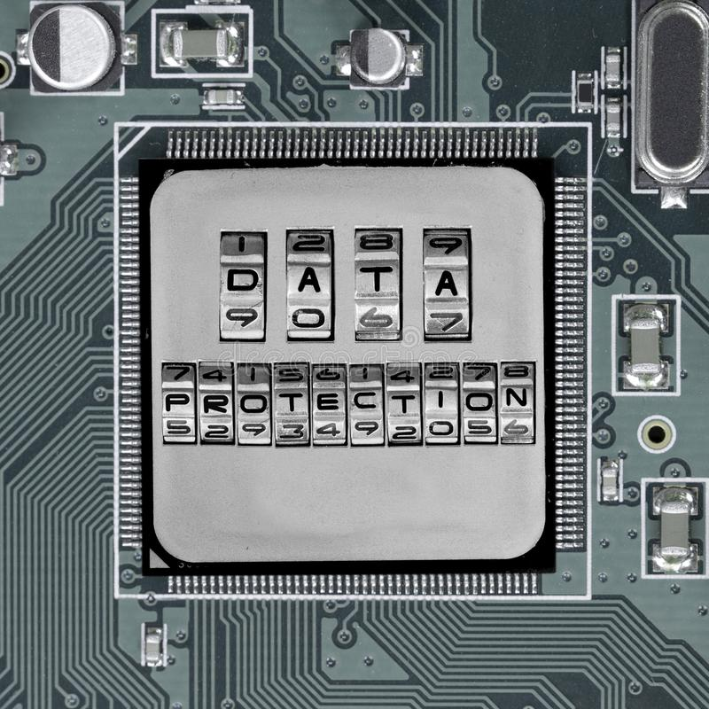 Circuitboard and Chip Concept. Macro photo of circuit board and chip with DATA PROTECTION words imprinted on metal surface stock images
