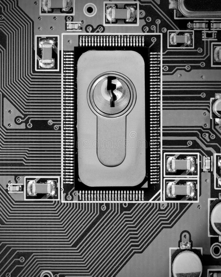 Circuitboard and Chip Concept. Macro photo of circuit board and chip with lock; concept of cyber security royalty free stock images