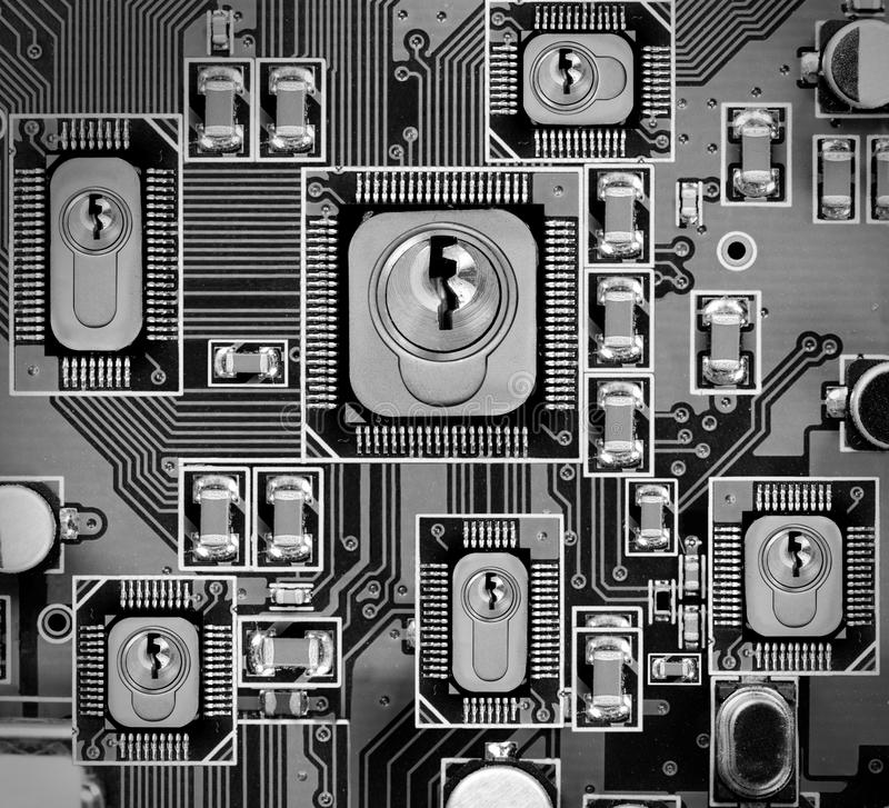 Circuitboard and Chip Concept. Macro photo of circuit board and chip with locks; concept of cyber and data security royalty free stock photography