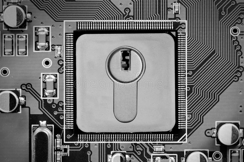 Circuitboard and Chip Concept. Macro photo of circuitboard and chip with DATA SECURITY words imprinted on metal surface royalty free stock photos