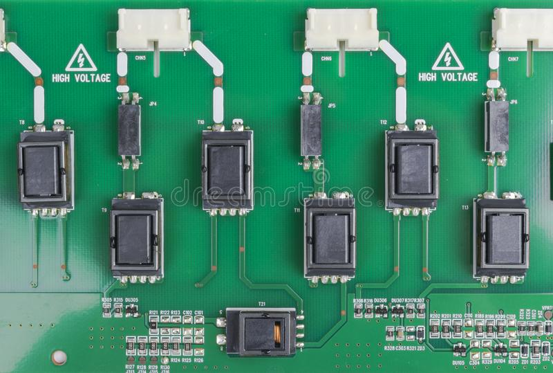 Circuitboard with resistors, microchips and electronic components. Electronic computer hardware technology. Integrated communicati royalty free stock photography