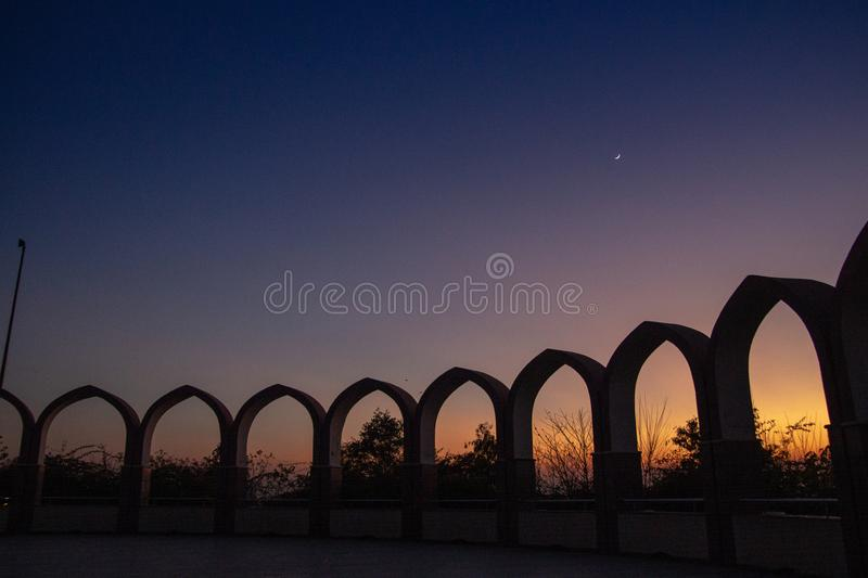 Circular array of arches in the Dark night sky stock photography