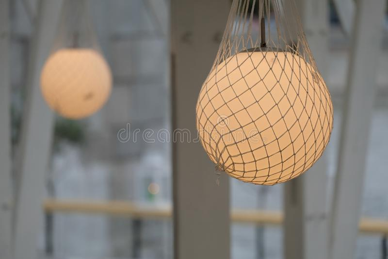 Circular chandelier. Suspended in a mesh royalty free stock images