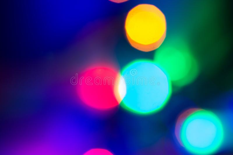 Circular colored bokeh over dark background. Circular colored bokeh taken with photocamera reflex over dark background royalty free stock images