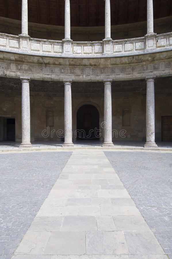 Circular courtyard. View of the circular courtyard in the palace of Carlos V, Alhambra, Granada, Andalucia, Spain royalty free stock image