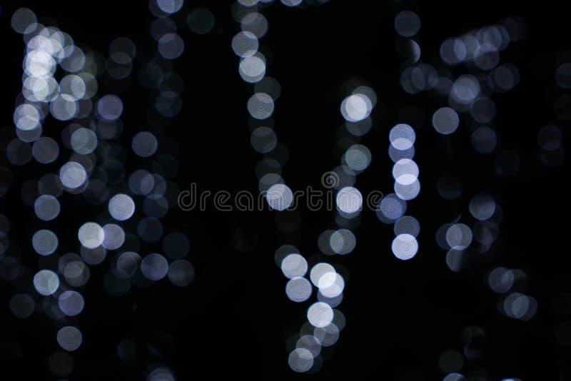 Circular do borrão do gajo do fogo, borrão da iluminação da cor e fora de foco com um fundo preto imagens de stock
