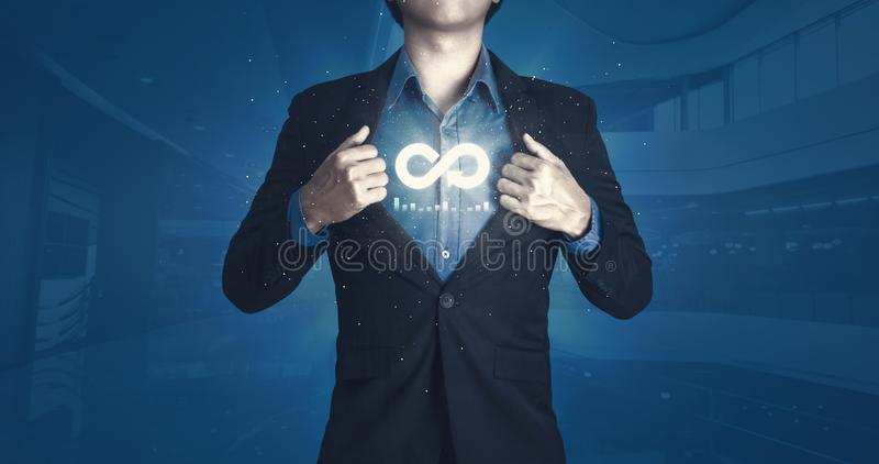 Circular economy with infinite concept. Business man showing arrow infinity symbol and future background. Graph showing the. Earnings, profits of business stock images