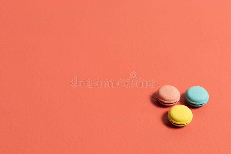 Circular erasers in pink blue and yellow colors on a coral table stock images