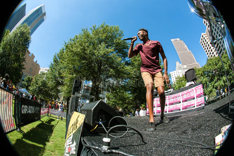 Circular Fisheye Of Male Rapper Performing At Hip Hop Festival. Atlanta, GA, USA - October 8, 2016: Circular fisheye perspective of unidentified male artist stock photos