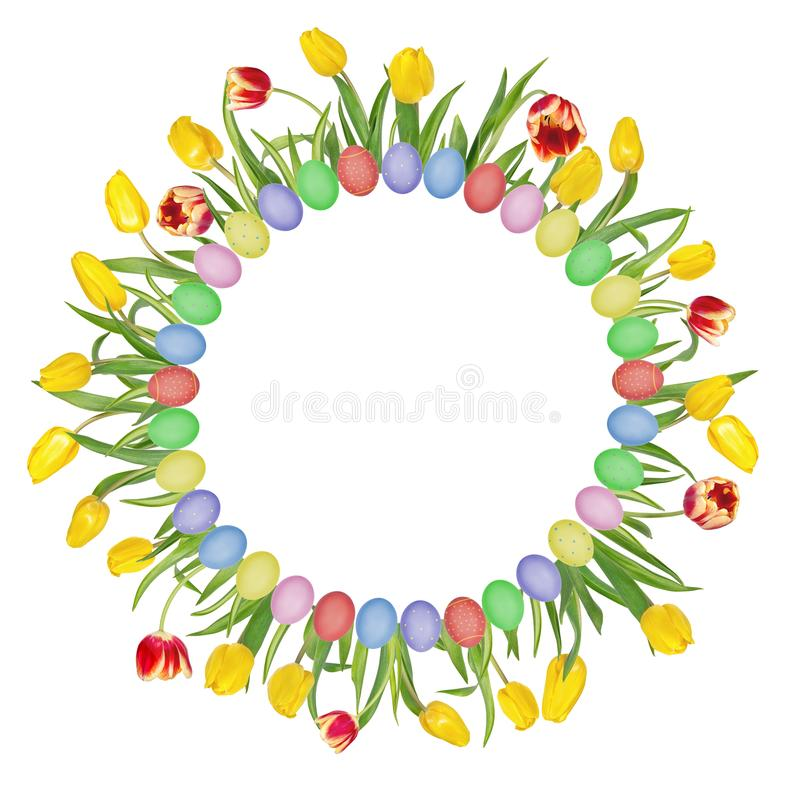 Circular floral frame made of beautiful red and yellow tulips and colorful easter eggs. Isolated on white background. royalty free stock images