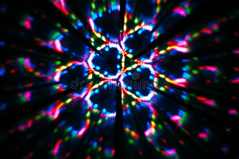 Circular image made with a kaleidoscope. Reflection of lights that generates images of fractal type. Abstract image of circular shape made with a kaleidoscope royalty free stock photo