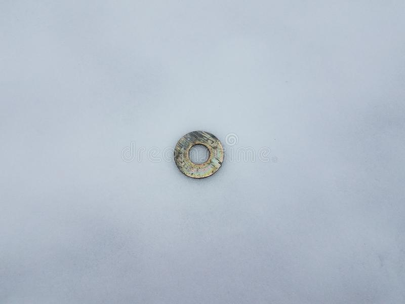 Circular metal disk or ring on white snow. And ice royalty free stock photos