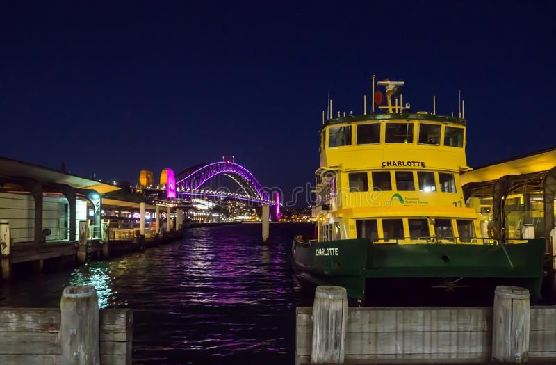 Circular quay wharf with the view of Sydney harbour bridge at night time. royalty free stock images