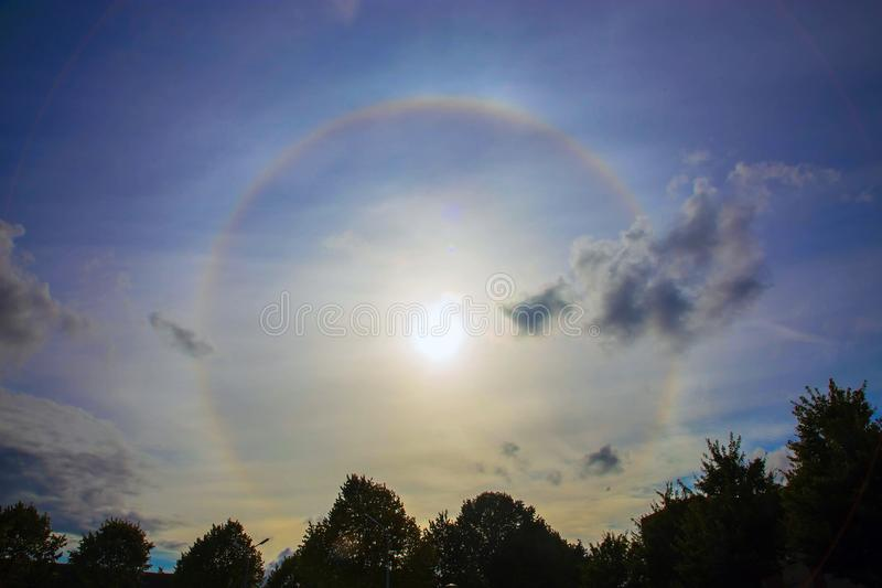 Circular rainbow around the sun. Halo. A rare atmospheric phenomenon stock image