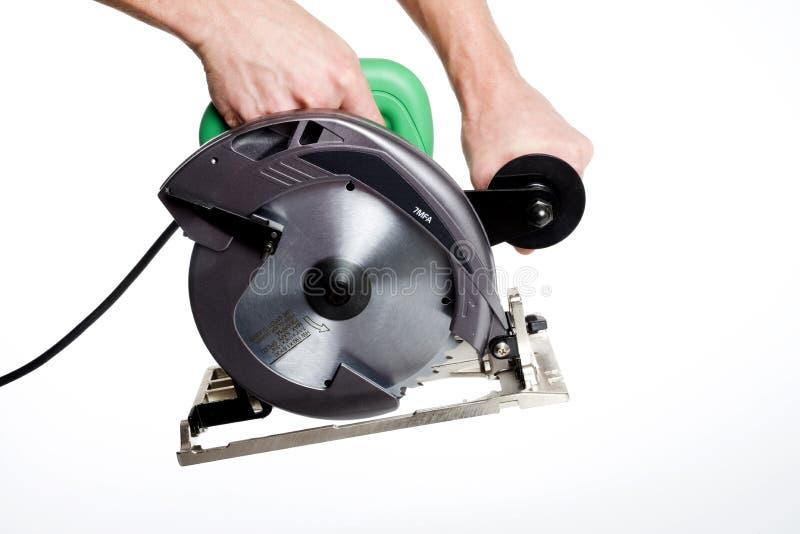 A circular saw. An electric circular saw for construction work stock photos