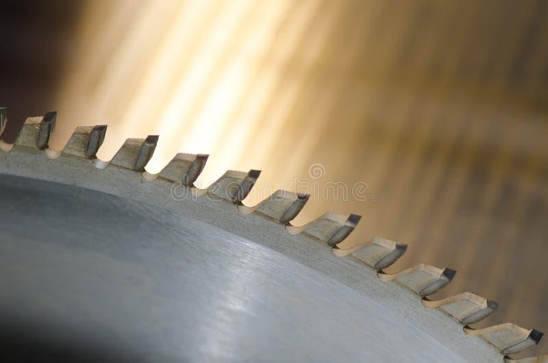Circular saw blade. Detail of a circular saw blade stock photo