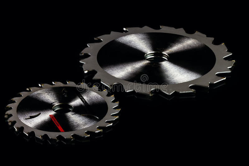 Circular saw blades. On black background, low-key stock images