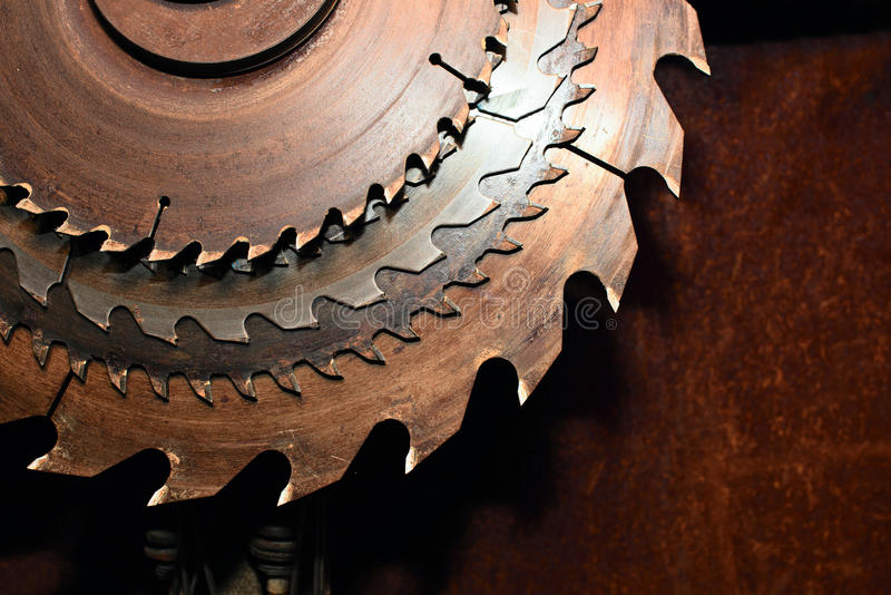 Circular saw blades. Industrial background with circular saw blades stock photography