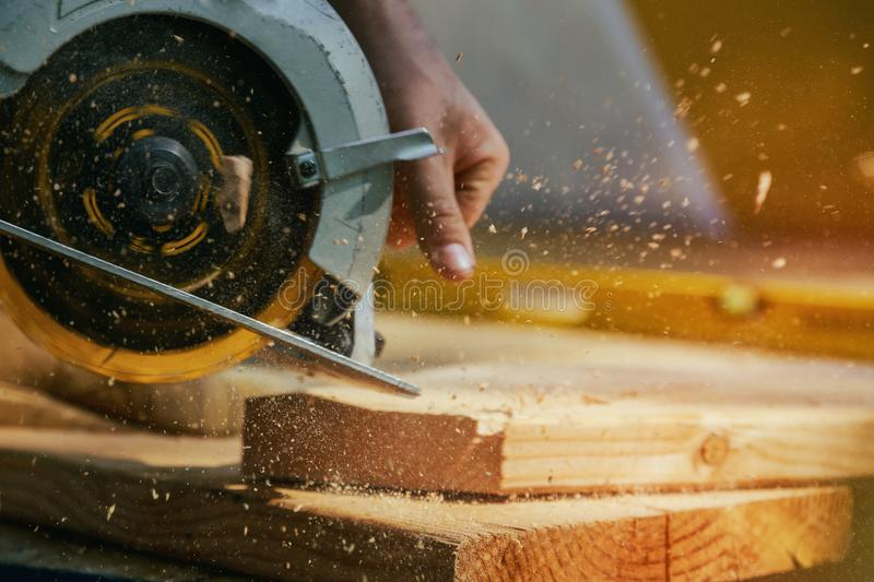 Circular Saw. Carpenter Using Circular Saw for wood beam. Carpenter Using Circular Saw for wood beam a new home constructiion project royalty free stock photography