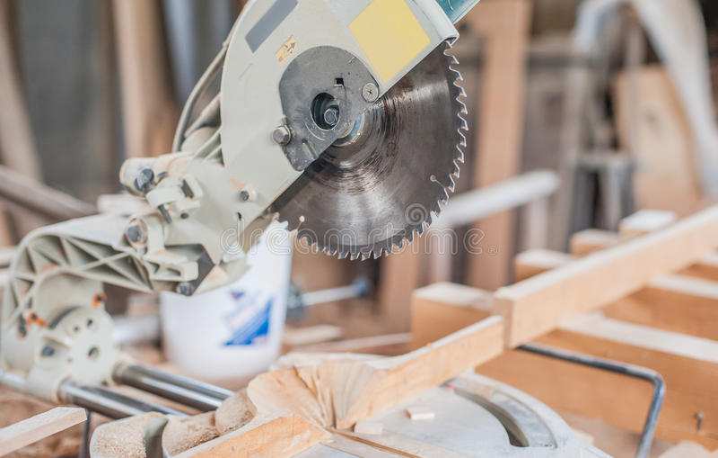 Circular Saw. Carpenter Using Circular Saw for wood royalty free stock photo