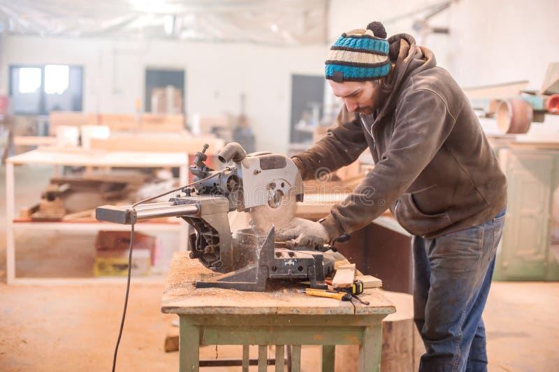 Circular Saw. Carpenter Using Circular Saw for wood stock photos
