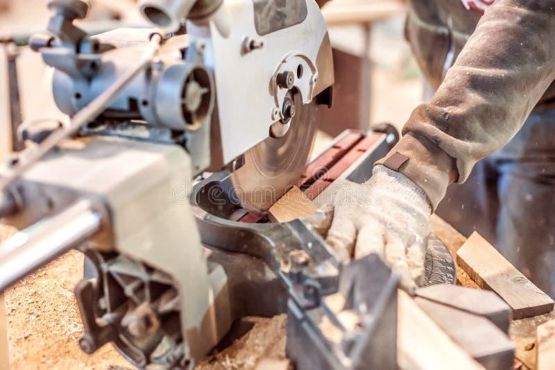Circular Saw. Carpenter Using Circular Saw for wood stock photography
