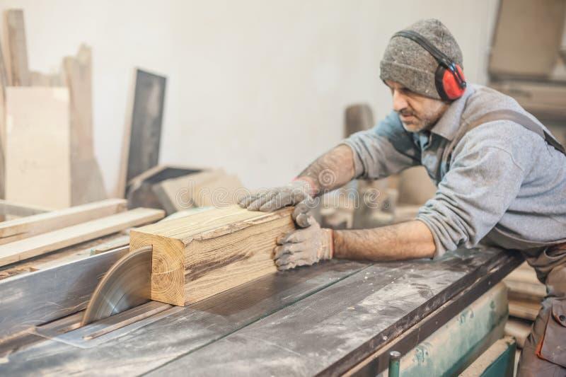 Circular Saw. Carpenter Using Circular Saw for wood royalty free stock image