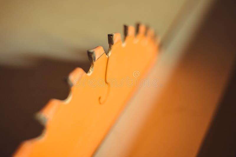 Circular saw. Carpentry. Electric saw table tool for woodwork. Orange circular saw close up. Woodworking tool. Circular Saw. Cutting boards. Carpenter work royalty free stock photos