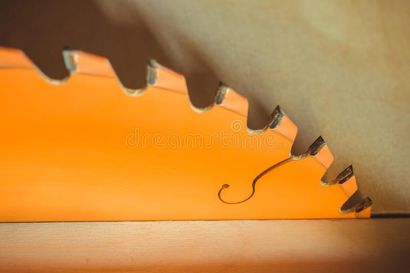 Circular saw. Carpentry. Electric saw table tool for woodwork. Orange circular saw close up. Woodworking tool. Circular Saw. Cutting boards. Carpenter work royalty free stock photography