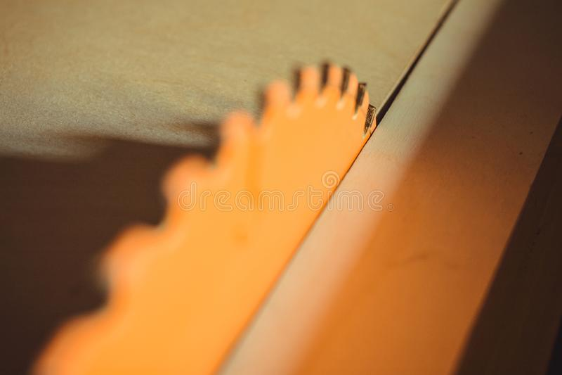 Circular saw. Carpentry. Electric saw table tool for woodwork. Orange circular saw close up. Woodworking tool. Circular Saw. Cutting boards. Carpenter work stock image
