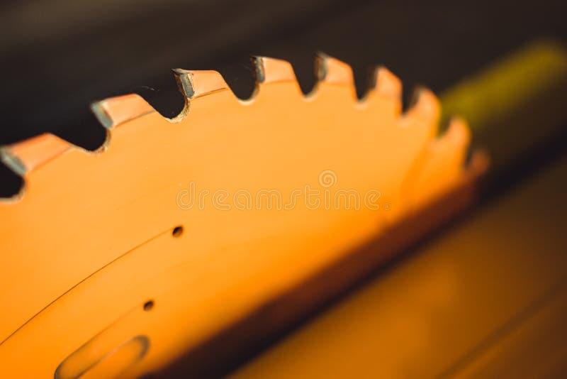 Circular saw. Carpentry. Electric saw table tool for woodwork. Orange circular saw close up. Woodworking tool. Circular Saw. Cutting boards. Carpenter work stock photo