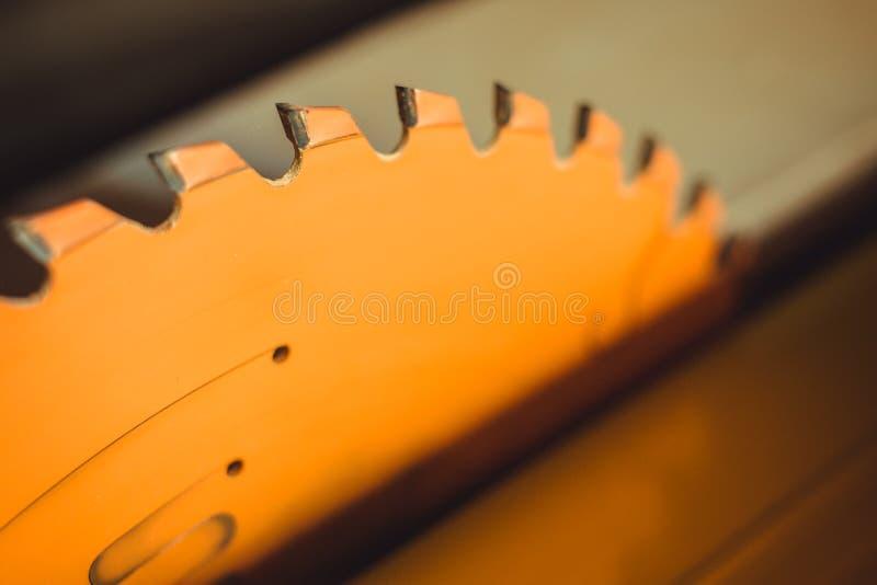 Circular saw. Carpentry. Electric saw table tool for woodwork. Orange circular saw close up. Woodworking tool. Circular Saw. Cutting boards. Carpenter work royalty free stock image