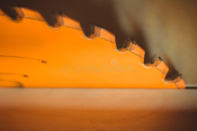 Circular saw. Carpentry. Electric saw table tool for woodwork. Orange circular saw close up. Woodworking tool. Circular Saw. Cutting boards. Carpenter work royalty free stock photo