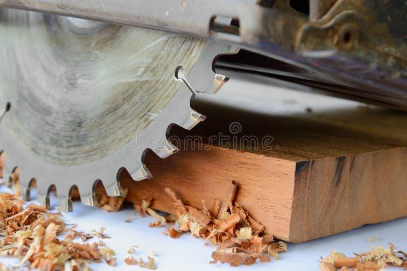 Circular saw. Close up of circular saw and saw dust stock photography