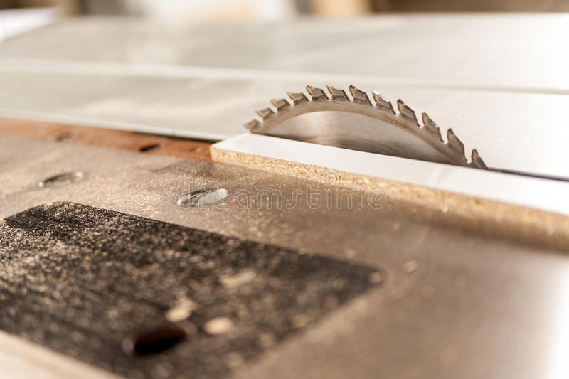 Circular saw covered with sawdust stock images