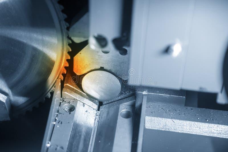 The circular saw machine cutting the metal rod. Raw material preparation process stock photo