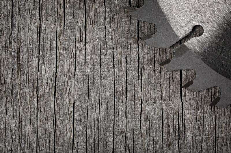 Circular saw on wooden background.  royalty free stock photography