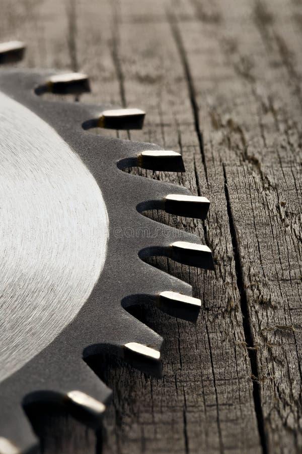 Circular saw on wooden background.  stock photos