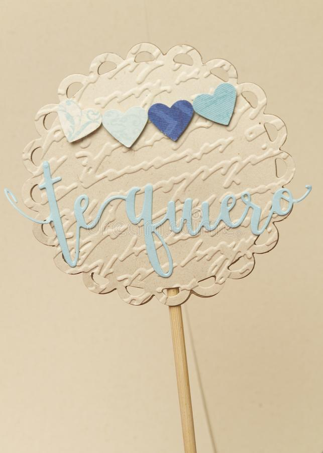 Circular sign made of paper with hearts and a I love you in Spanish royalty free stock photography