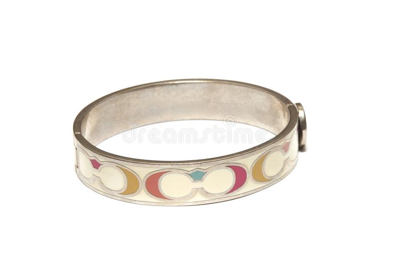 A circular stainless steel latch locking bracelet bangle royalty free stock photos
