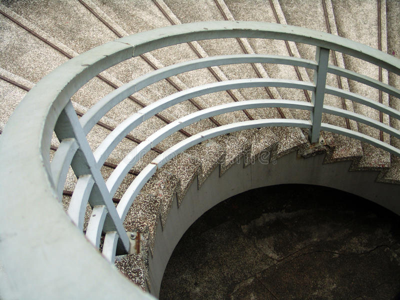 Circular stairs. Circular cement stairs going downwards stock photos