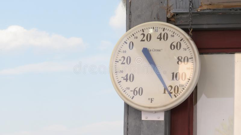 Too hot for the thermometer. A circular thermometer and it's arrow pointing royalty free stock photo