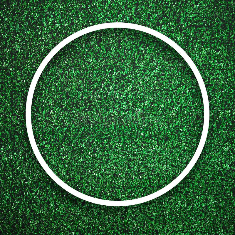 Circular white frame edge on green grass with shadow background. Decoration background element concept. Copy space for text insert royalty free stock photography