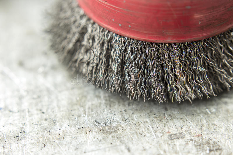 Circular wire brush on workbench stock photo