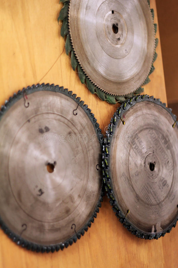 Circular wood saw blades mounted on a wall in a woodshop stock photography