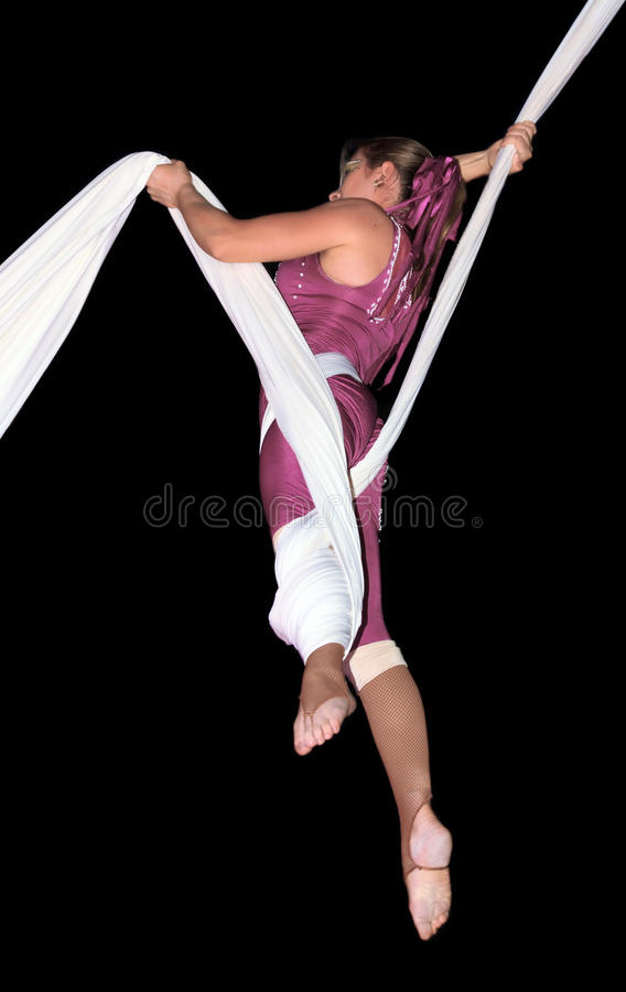 Circus artist. Performing an acrobatic act over a pure black background - Victor Hugo Cardinalli Christmas Show royalty free stock photography