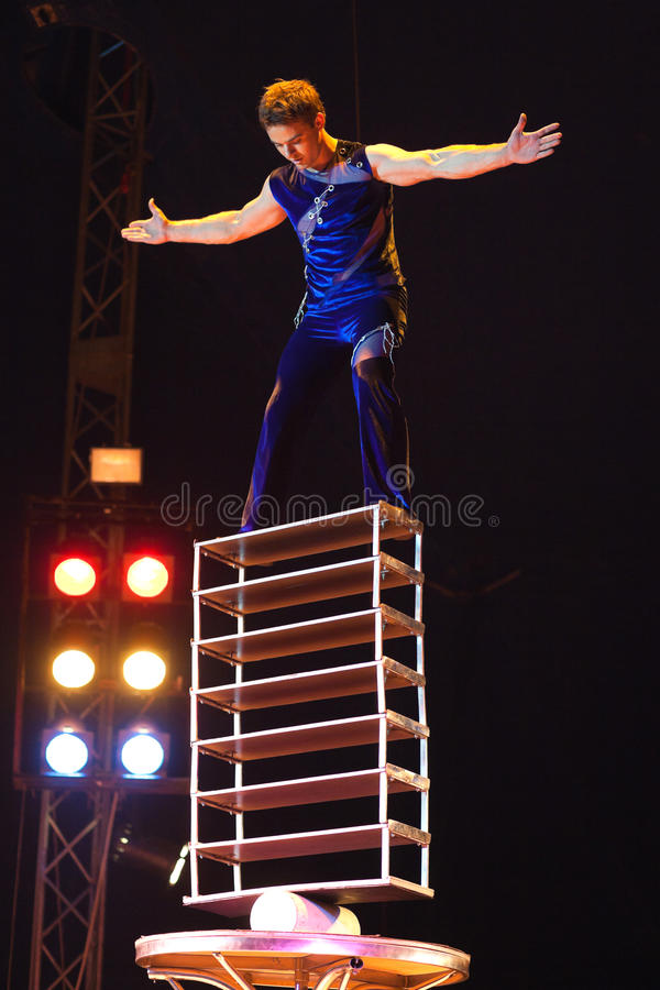 Circus artist. Orlando, circus artist and owner during his balance act, Bucharest, Romania royalty free stock photo