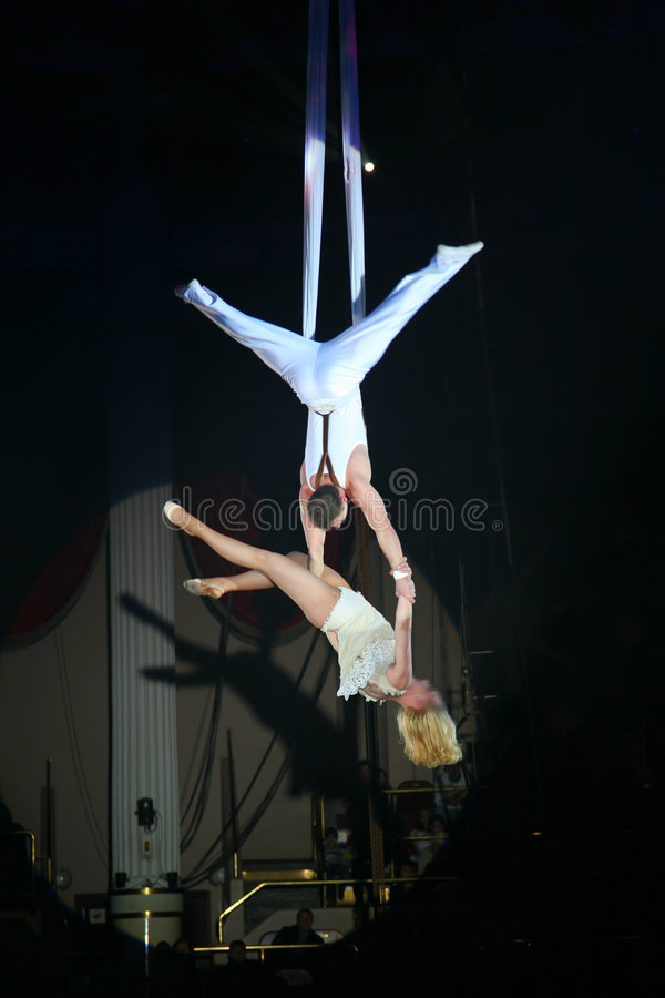 Circus artists. Show acrobatic number stock images