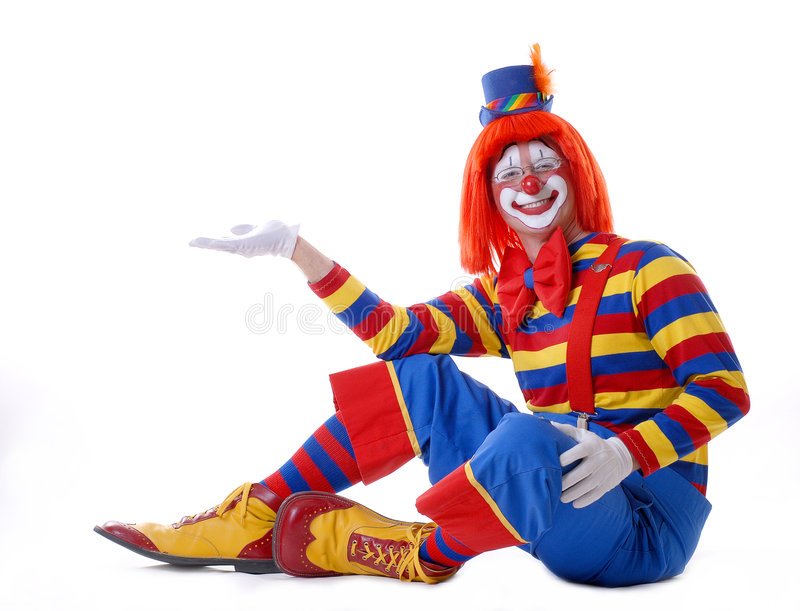Circus Clown. Sitting circus clown holding your product in his hand stock photos
