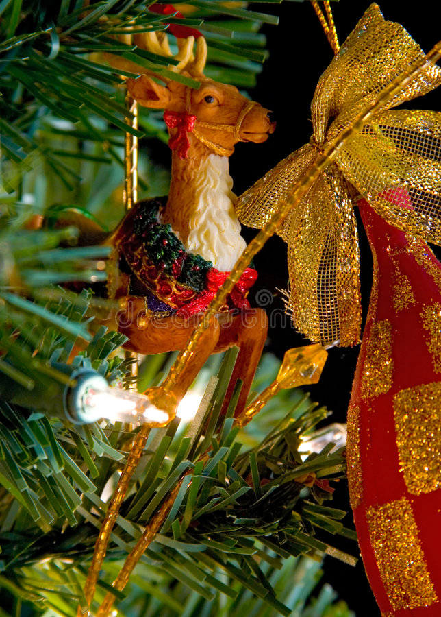 Circus raindeer christmas decoration on a tree stock photos